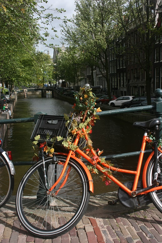 Bike on a canal in Amsterdam
